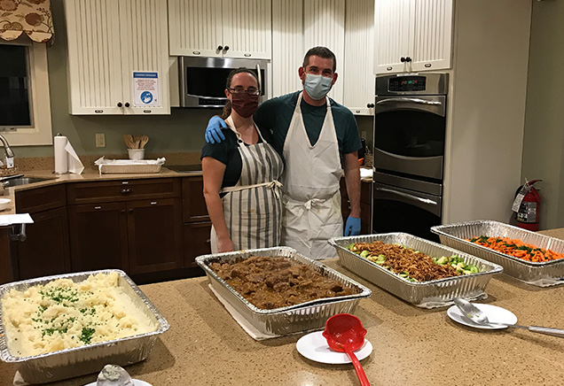 Volunteers pose with a hearty meal prepared for families at the Albany Ronald McDonald House
