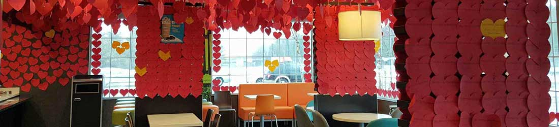 Restaurant walls covered with red paper hearts
