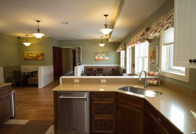 Large, open kitchen with tan marble countertops