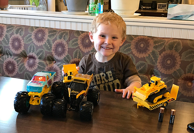 Boy plays with trucks at Albany Ronald McDonald House