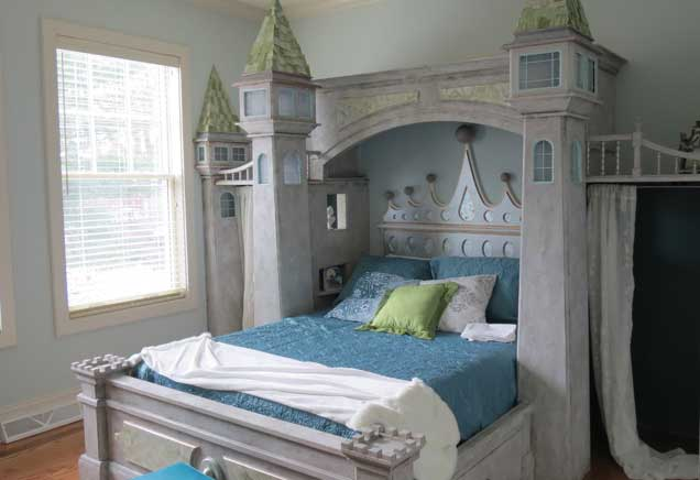 Queen bed shaped like a castle with blue and green bedding