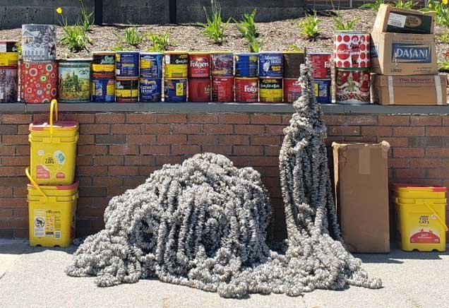 Boxes, cans and strings of soda can pull tabs