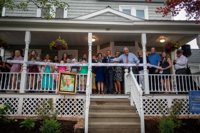 RMHC-CR staff, board members, dignitaries, family members, and friends cut the ribbon for the new Ronald McDonald Family Retreat at Krantz Cottage in Lake George, N.Y. on Wednesday, July 14, 2021