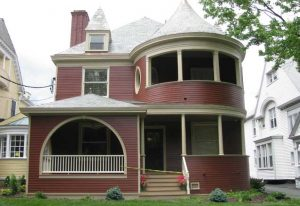 Red Victorian house with large front porch