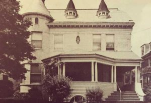 Sepia-toned photo of Victorian-style house